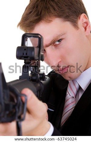 Close up of angry businessman man with gun on white background - stock photo