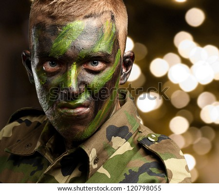 Close Up Of Angry Soldier against a background of shiny lights - stock photo