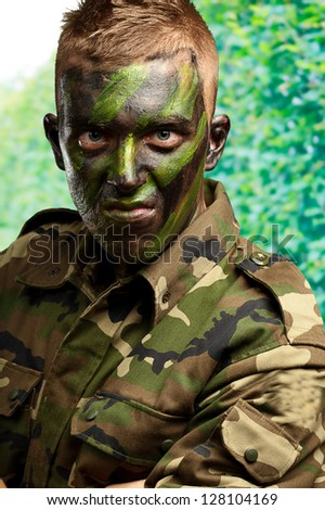 Close Up Of Angry Soldier against a nature background - stock photo