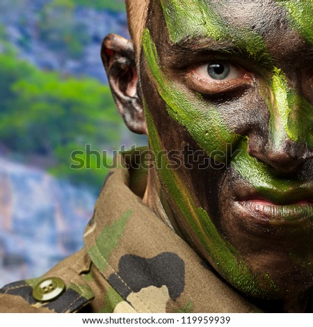 Close Up Of Angry Soldier, outdoor - stock photo
