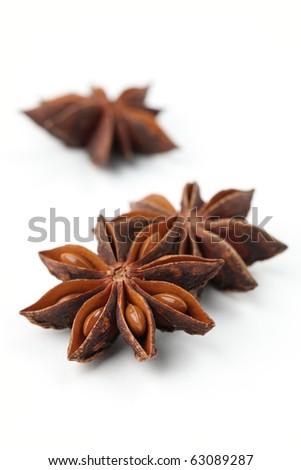 Close-up of anise on white background. Shallow dof - stock photo