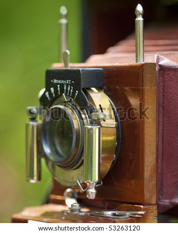 Close up of antique camera lens with very limited DOF - stock photo