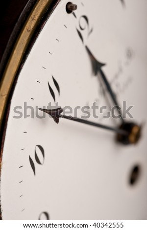 Close-up of antique clock, nearly midnight, macro lens