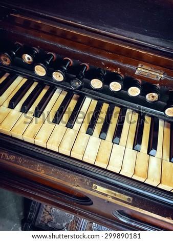 Close-up of antique reed organ (harmonium). - stock photo