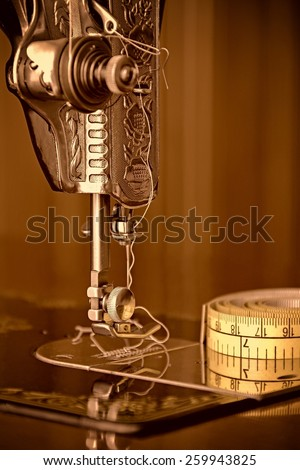 Close-up of antique sewing machine. - stock photo