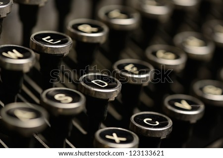Close-up of antique typewriter keys. Close-up of keys on an old typewriter. Very shallow DOF. - stock photo