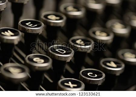 Close-up of antique typewriter keys. Close-up of keys on an old typewriter. Very shallow DOF. - stock photo