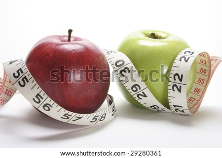 Close Up of Apples and Tape Measure