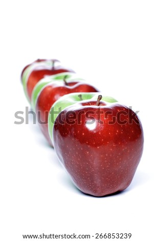 Close-up of apples in row on white background - stock photo