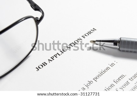 close up of application for employment document - stock photo