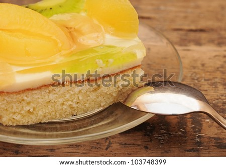 Close-up  of apricot cake on glass plate on wooden table
