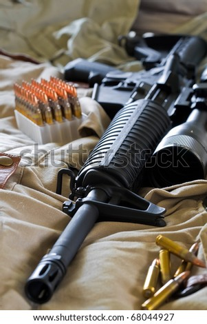 Close-up of AR-15 rifle and ammo - stock photo