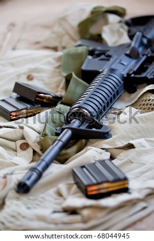 Close-up of AR-15 rifle and magazines with ammo - stock photo