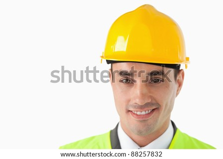 Close up of architect with helmet on against a white background