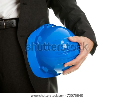 Close-up of architect/worker holding hard hat - stock photo