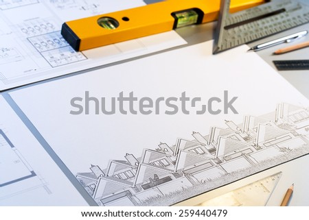 Close up of architectural design plans with measuring objects. - stock photo