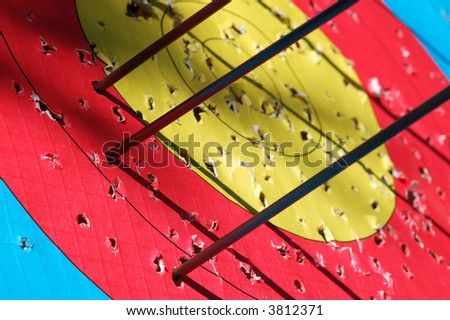 Close-up of arrows hitting the target - stock photo