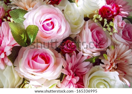 close up of artificial flowers bouquet arrange for decoration in home  - stock photo