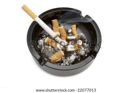 close up of ashtray and cigarettes on white background with clipping path - stock photo