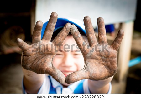 close up of Asian child hands in potter craft - stock photo