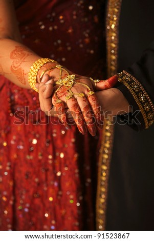 Close up of Asian couple's hands at a wedding, concept of marriage/partnership/commitment - stock photo