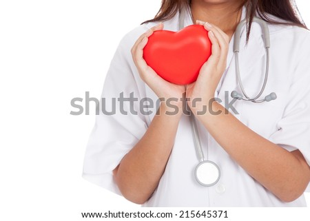 Close up of Asian female doctor hold a red heart and  isolated on white background