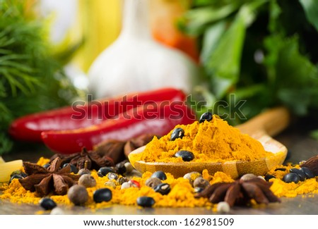 close-up of Asian spices around a wooden blade, still life - stock photo