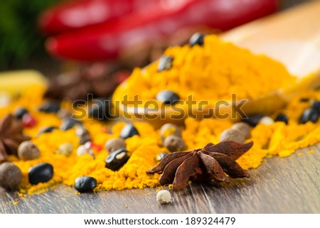 close-up of Asian spices around a wooden blade, still life