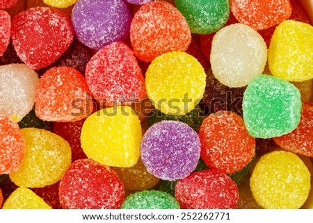 Close up of assorted multicolored gum drops.  - stock photo
