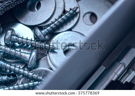 Close up of assorted steel screws and washers - stock photo