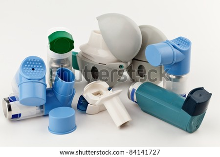 Close-up of asthma inhalers on white background. - stock photo