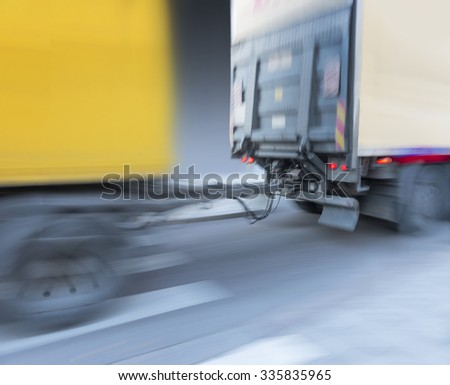Close up of attachment of trailer to truck in blurred motion