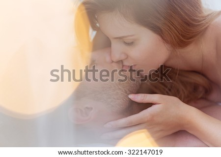 Close-up of attractive amorous couple kissing tenderly