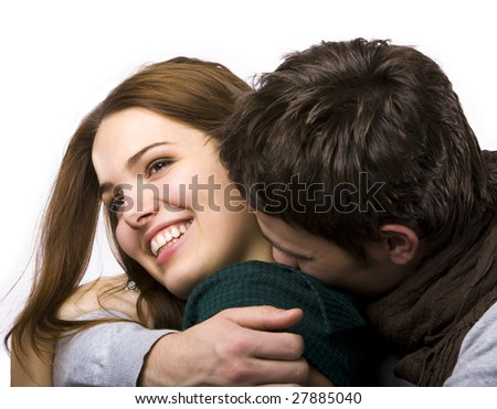 close up of attractive couple passionately in love hugging and smiling - stock photo