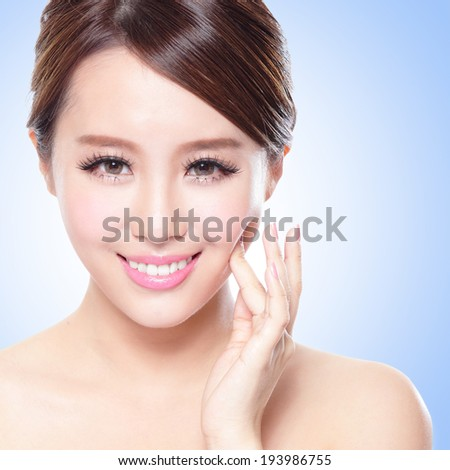 close up of attractive Skin care woman face with blue background, asian - stock photo