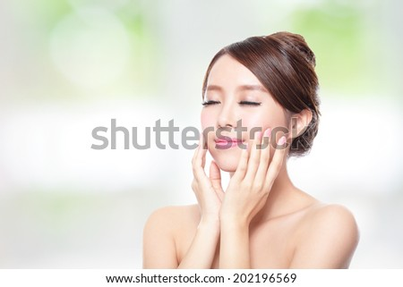 close up of attractive woman face relax closed eyes with nature green background, asian beauty - stock photo