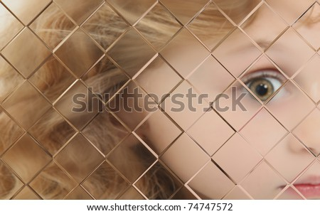 Close Up Of Autistic Child Behind Pane Of Glass - stock photo