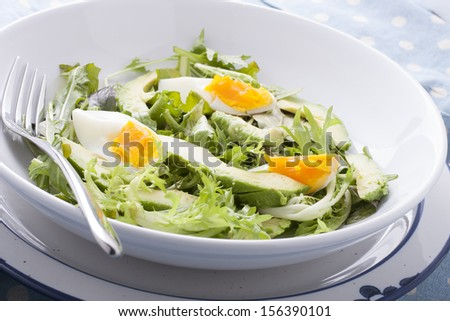 Close up of avocado salad with boiled eggs