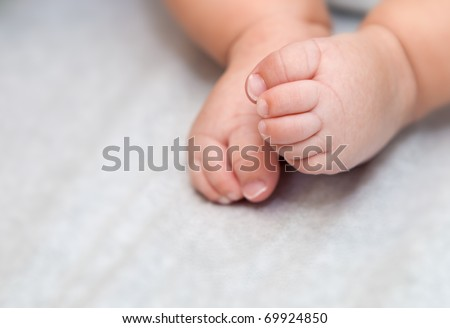 Close-up of baby feet with selective focus - stock photo