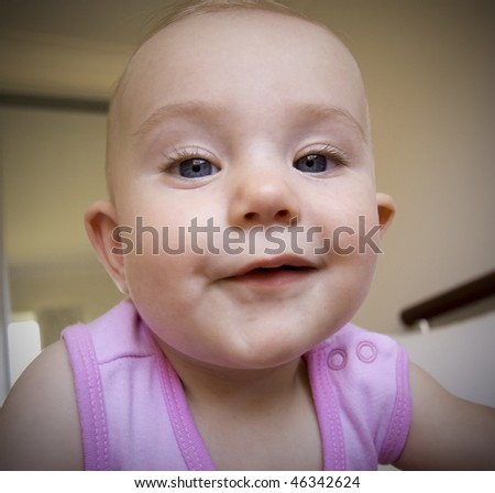 close up of baby girl wearing pink - stock photo