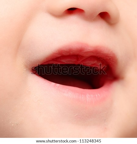 close up of baby mouth - stock photo