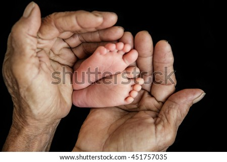 Close-up of baby's hand holding mother's finger (Soft focus and blurry) - stock photo