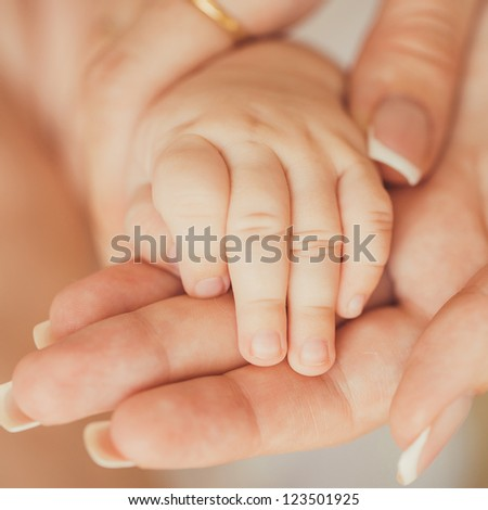 Close-up of baby's hand in mother's hand