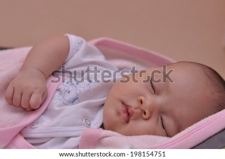 Close-Up of Baby Sleep in Pink Blanket  - stock photo