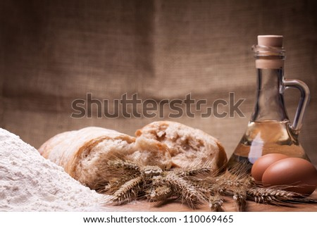 Close up of baking ingredients on wooden table - stock photo