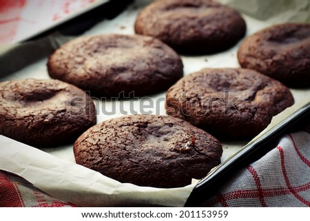 Close up of baking tray with chocolate biscuits - stock photo
