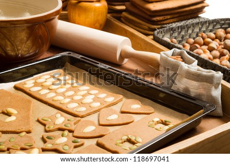 Close-up of baking tray with gingerbread cookies and ingredients