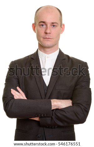 Close up of bald Caucasian businessman with arms crossed isolated against white background