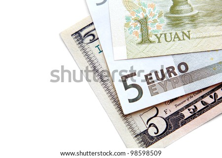 Close-up of banknotes (dollar, euro, yuan). In a separate white background. - stock photo