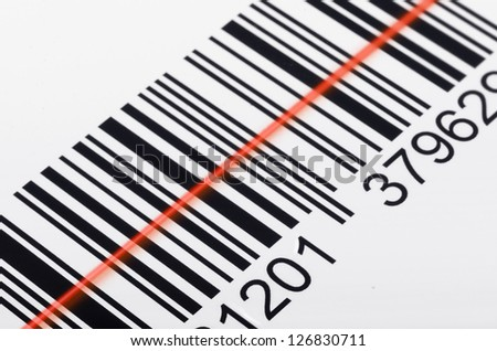 Close-up of barcode with laser scanner beam - stock photo